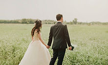 woman-in-white-wedding-dress-holding-han