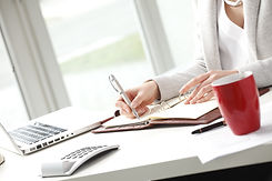 Close-up of businesswoman sitting in off