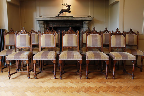 A set of 12 19th Century Gothic Revival Dining Chairs - £9800