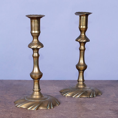 A Pair of 18th Century Brass Swirl Based Candlesticks - £1200