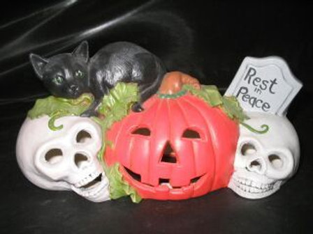 Cat on pumpkins with tombstone