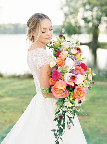 Lakside bride with flowers