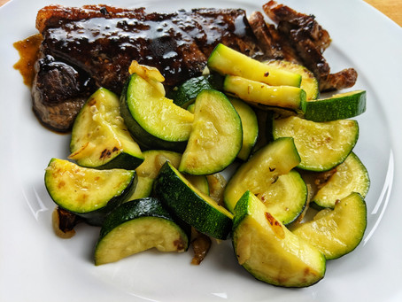 New York strip steak with red wine reduction and Zucchini