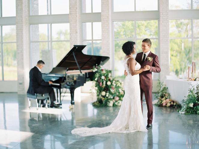 Couple dancing to piano music