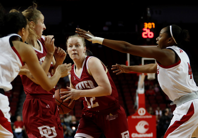 Denver Pioneers Claire Gritt (12) and Samantha Romanowski (22) guards the ball against Nebraska Huskers Nicea Eliely (5) and Sam Haiby (4) at Saturday night's NCAA women's basketball game at the Pinnacle Bank Arena in Lincoln, Nebraska.