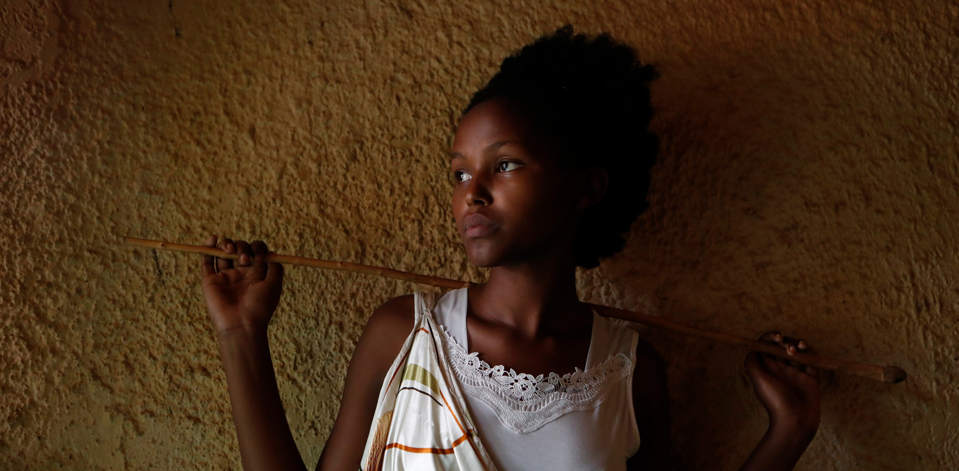 Diane Uwera (18), one of the few Rwandan women cow poets poses in her house in Bugesera, Rwanda.