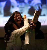 """Bich Chau (left), 53, embraces her daughter, Tiffany Truong (right), 22, on her 22nd birthday after the announcement of her acceptance into medical school at a talent show held at the University of Nebraska-Lincoln, on Saturday, Feb. 10, 2018 in Lincoln, Neb. Chau immigrated to America from Vietnam in 1981 to find a job. Initially not knowing a word of English, Chau graduated at the top of her class at Lincoln High. She went on to graduate from UNL's College of Medicine with a medical degree. """"There is truly no accolade I could ever win in my life that would mean more to me than being her daughter,"""" said Truong."""