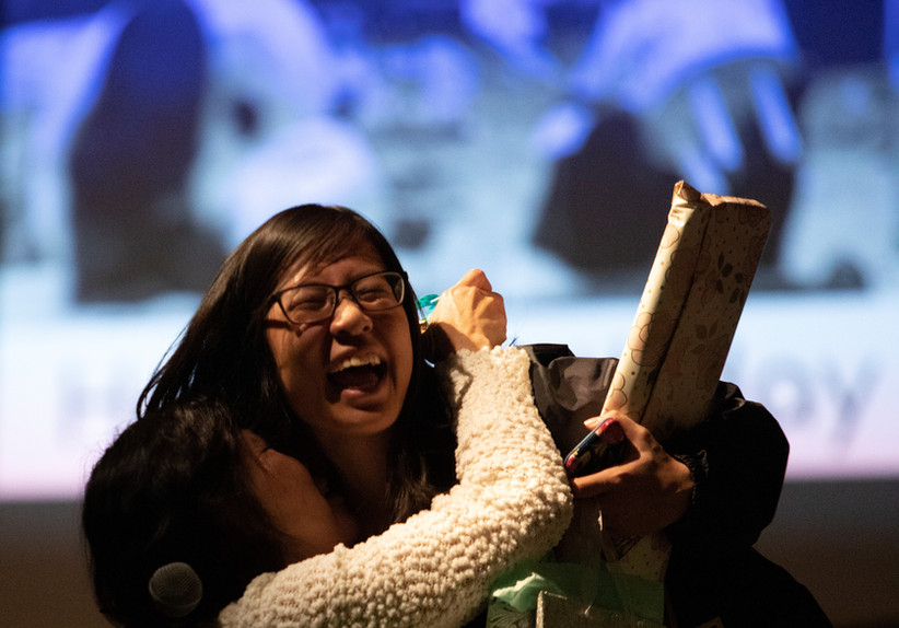 Bich Chau (left), 53, embraces her daughter, Tiffany Truong (right), 22, on her 22nd birthday after the announcement of her acceptance into medical school at a talent show held at the University of Nebraska-Lincoln in Lincoln, Nebraska.