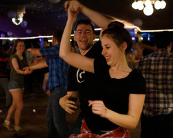 A couple swing dances at Pla Mor ballroom on Sunday, Apr. 29, 2018 in Lincoln Neb. Country Sundays are held every Sunday night at Pla Mor where country music and swing dancing are the highlight of the evening. People come from all around the area to participate in the event held weekly. Different country bands are scheduled every week playing a variety of country songs ranging from old hits to recent favorites.