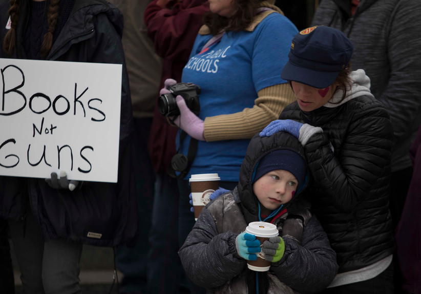 A mother embraces her son at March for Our Lives, a rally for gun control held at the Lincoln State Capitol in Lincoln, Nebraska.