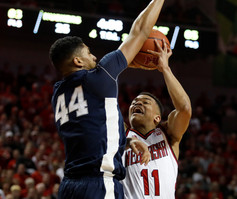 """Nebraska Cornhuskers' Evan Taylor (11) goes for the shot against Indiana Hoosiers' Julian Moore at Sunday night's season finale game at the Pinnacle Bank Arena in Lincoln, Neb. on Feb. 25, 2018. Nebraska lead the entire game closing the night at 76-64. This marks a record number of season wins by the Cornhuskers at 13-5 wins while Penn State finishes with 9-9. This ties Nebraska for fourth place with the University of Michigan in the Big Ten Conference while Penn State ties with Indiana University for seventh place. """"It was fun to watch,"""" said Ellie Samson, a Nebraska fan, """"[Nebraska] has brought a lot of excitement to the sport that is needed."""""""