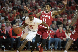 """Nebraska Cornhuskers' Glynn Watson Jr. (5) drives past Indiana Hoosiers' Devonte Green (11) during the first half at Tuesday night's NCAA basketball game at the Pinnacle Bank Arena in Lincoln, Neb. on Feb. 20, 2018. Indiana led the first half with Nebraska trailing behind by one point. The Huskers won the night 66-57 making this their 12th win this season keeping them in fourth place in the Big Ten Conference while Indiana remains sixth in ranking. This ties Nebraska for their school record of most conference victories, the last being during their 1965-66 season. """"I think [Nebraska] played great,"""" said Jessica Effle, a Husker fan, """"they pulled through in the second half."""" Nebraska concluded 2017's season at 12th place while Indiana placed 11th."""