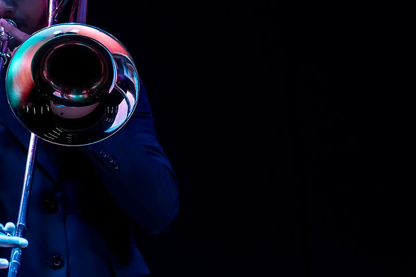 a man hands playing on a trombone black