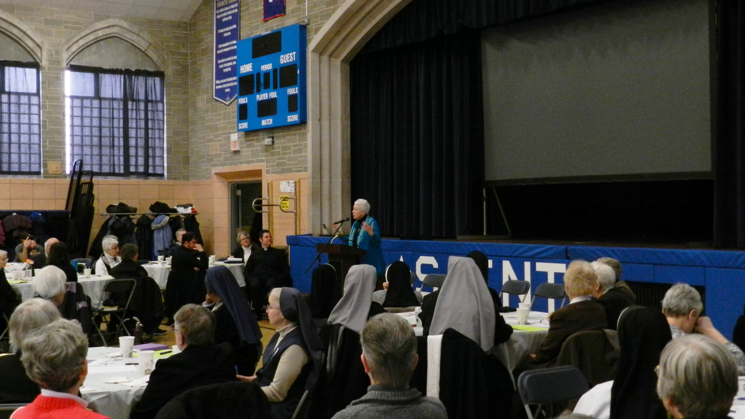 Sister Patricia Crowley, OSB with crowd.
