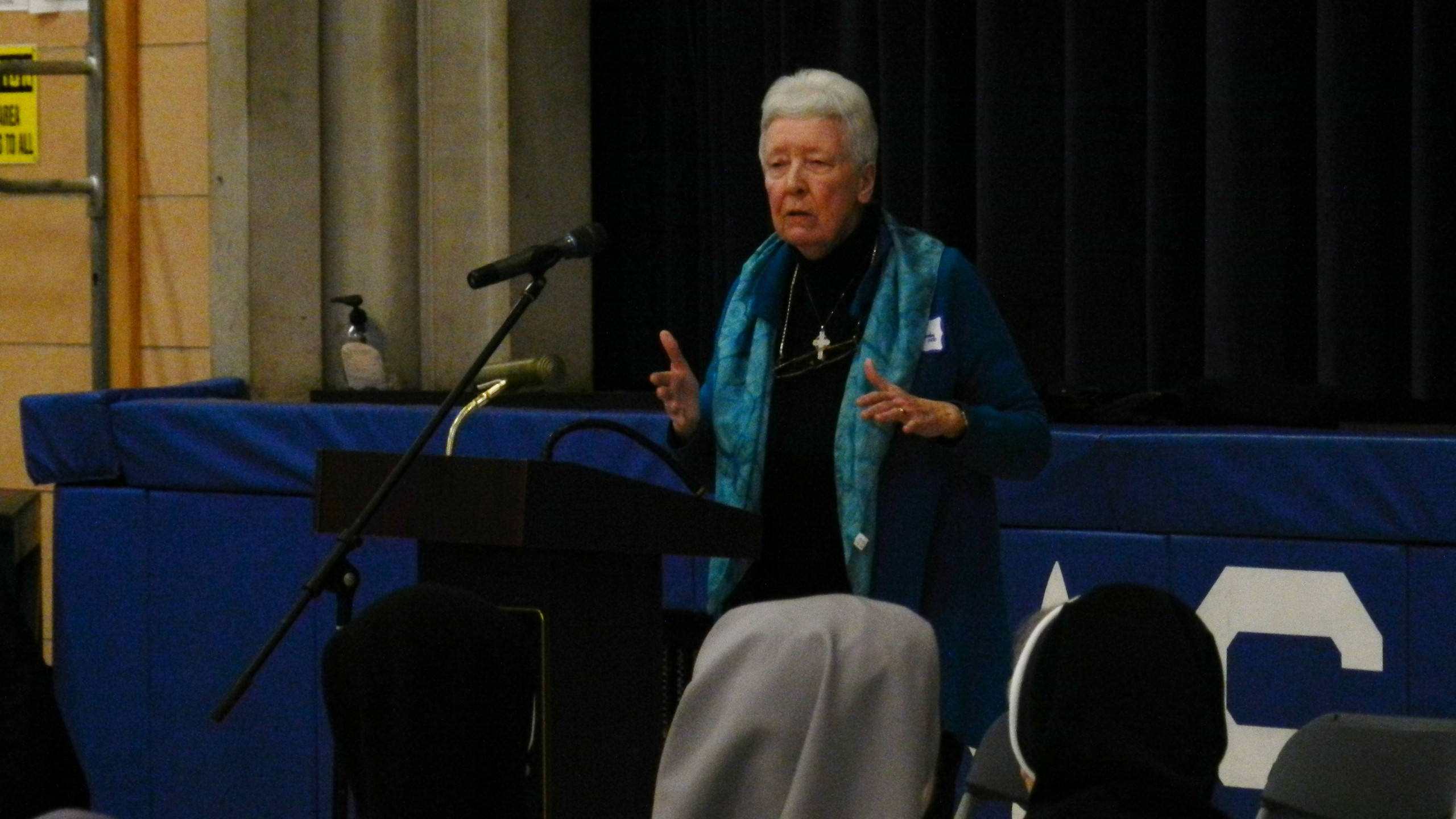 Sister Patricia Crowley, OSB at the podium