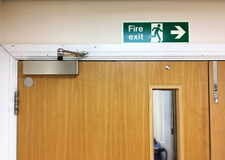 Fire exit sign above the door. Selective