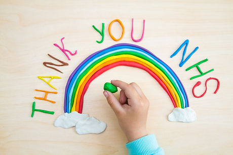 "The text ""thank you NHS"" and a rainbow w"