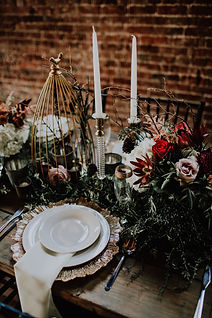 Table Setting with Bird Cage and Candlesticks