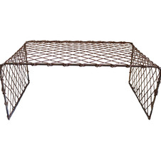 Metal coffee table  This metal fence coffee table adds a nice mix of texture to a lounge setup.  Dimensions: 40 x 23 x17 Quantity: 1