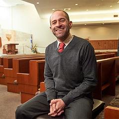Rabbi David in Sanctuary Smiling.jpg