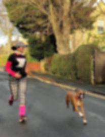 Holly jogging a dog in Malton