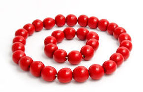 red-wooden-beads-bracelet-isolated-white