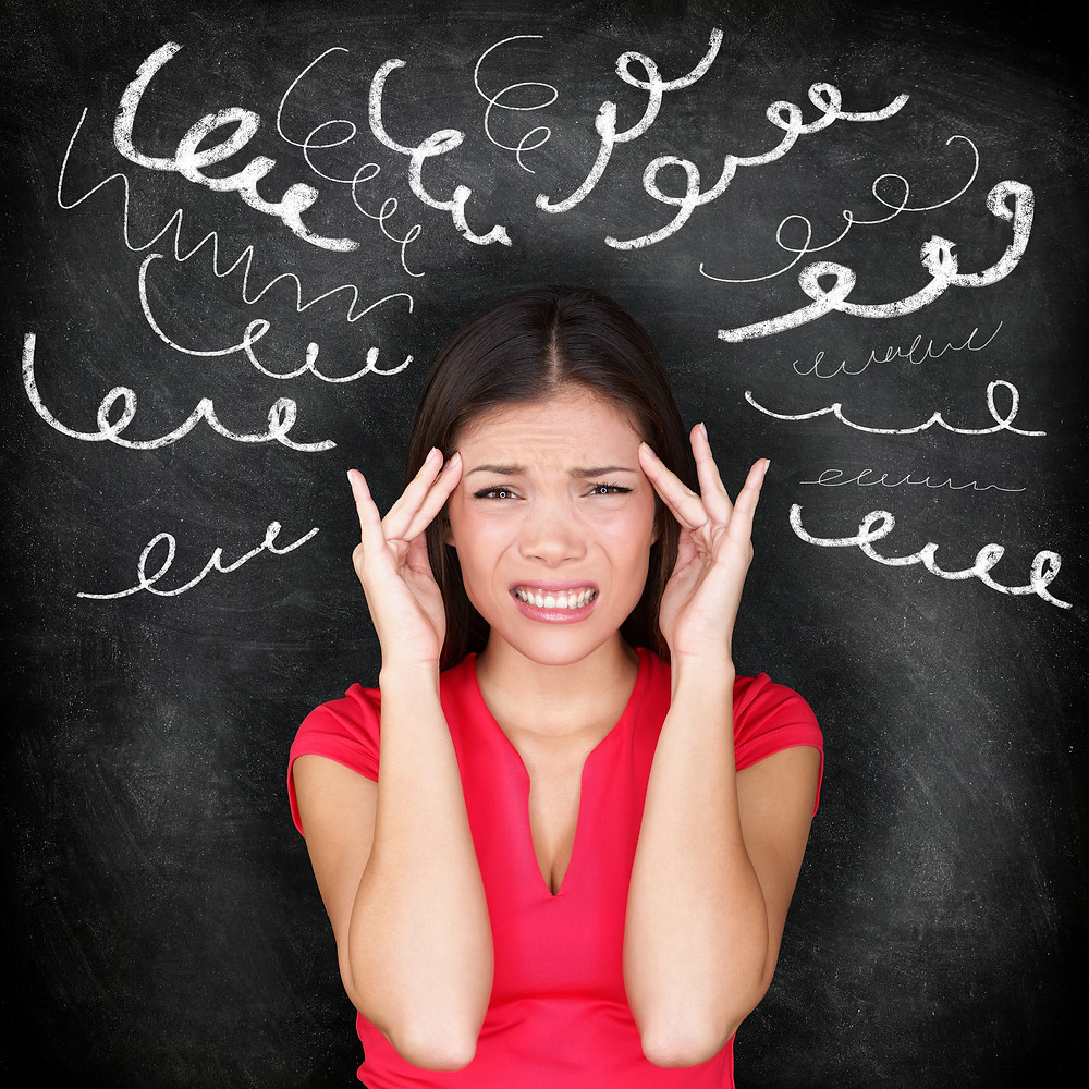 Stress - woman stressed with headache. Female stressed and worried with migraine