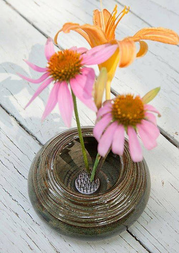 Flower arrangement vase.  Fill water in the base, stick the flowers into place.