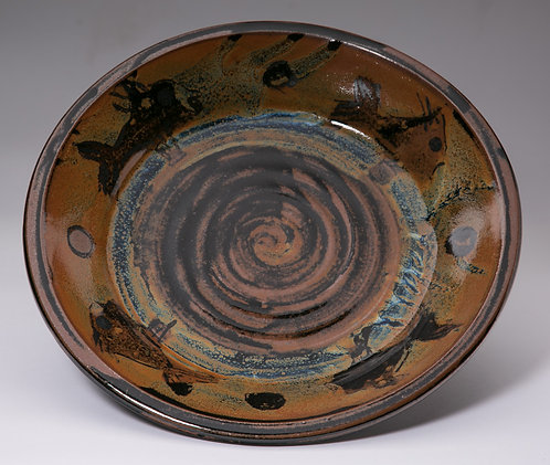 Large 12 inch plate with fish motif.