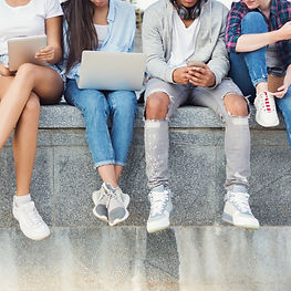 108642467-company-teen-friends-sitting-o