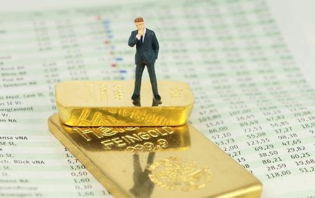 Business man at gold bars.jpg