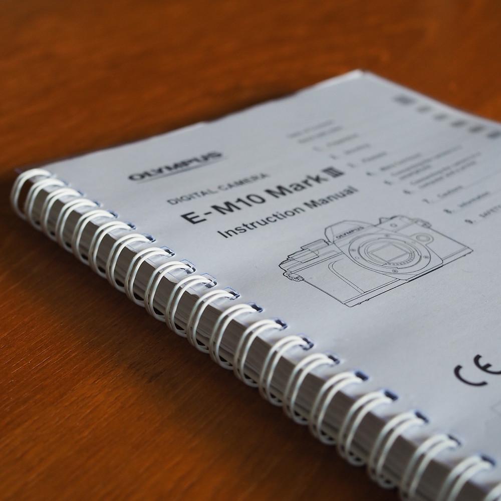 Spiral bound printed manual for digital camera .
