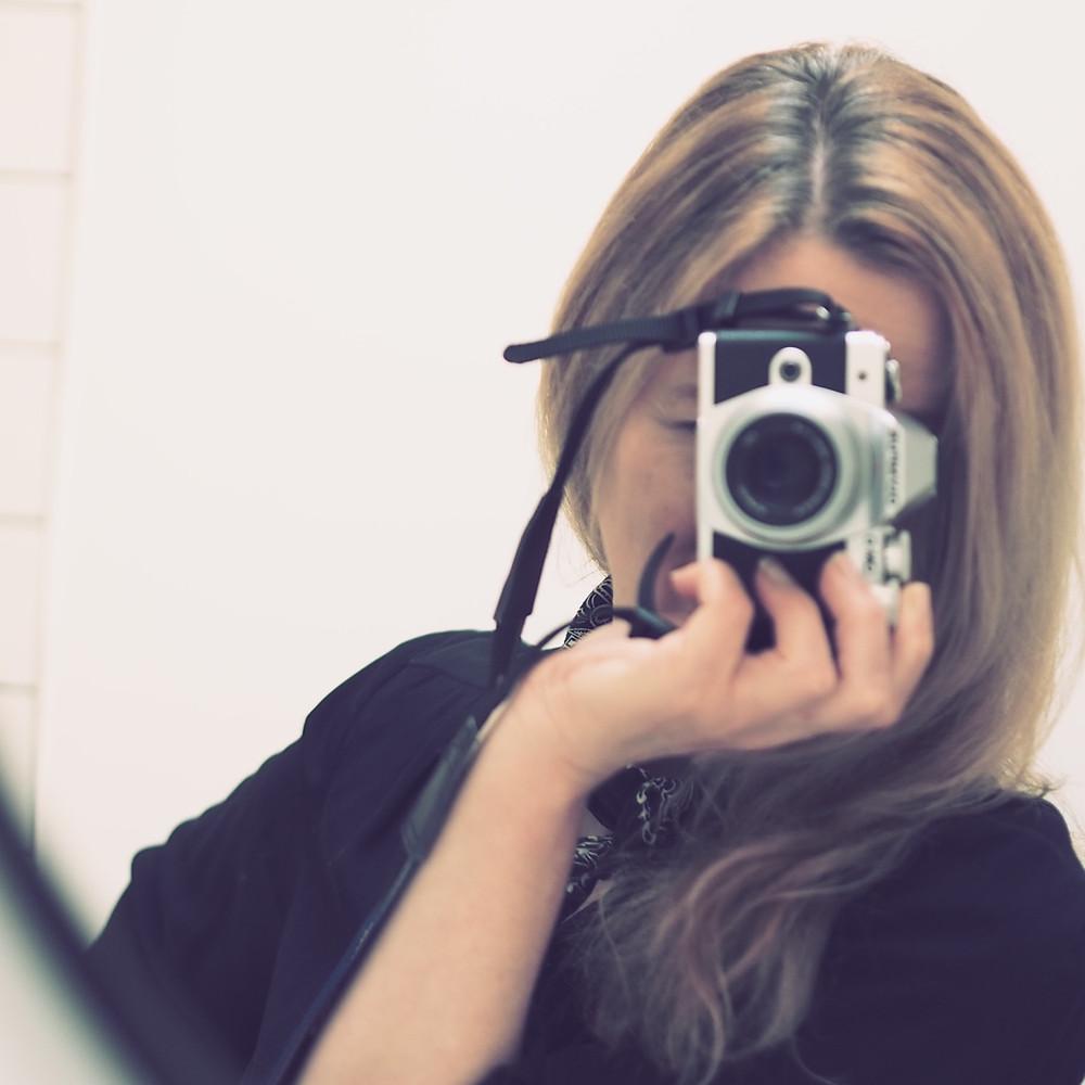 Vintage Art Filter in Olympus E-M10 Mark III selfie in mirror . Old expired film look from DSLR camera . Retro look shots from digital camera .
