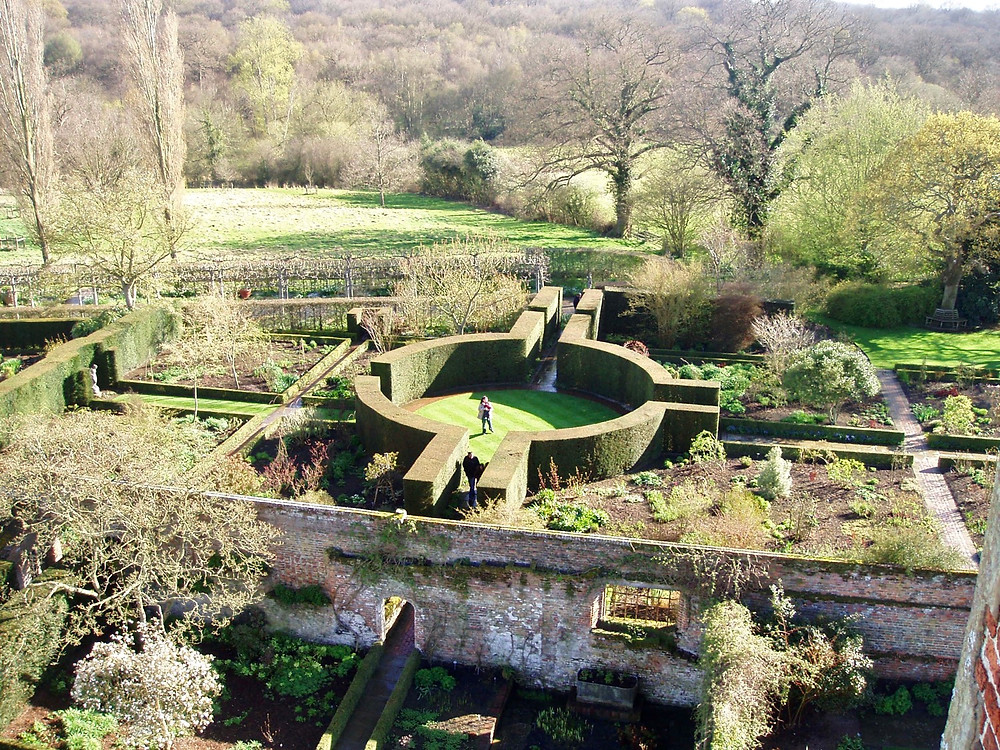 Sissinghurst formal garden view in Spring from Tower .
