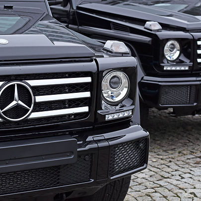 two black mercedes G-class SUVs