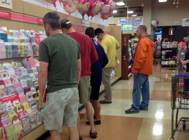 Men shopping for cards