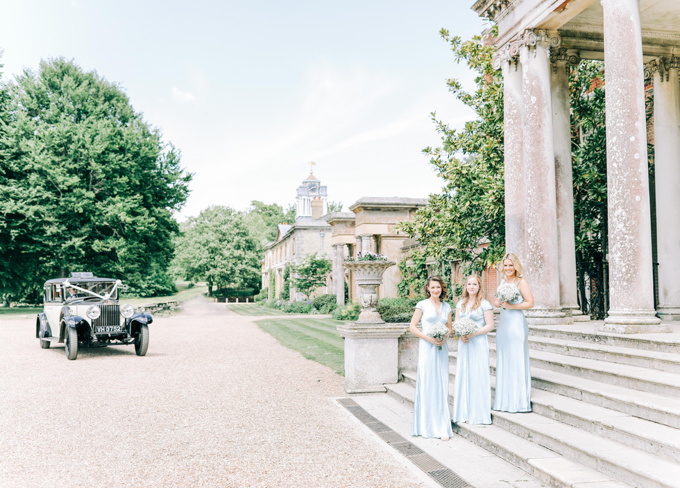 Bridesmaids waiting on the steps.