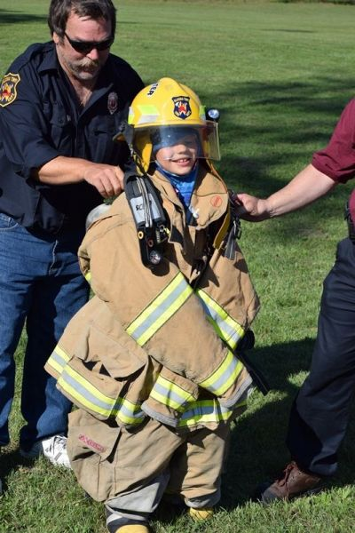 CR Trying on Fireman's Gear