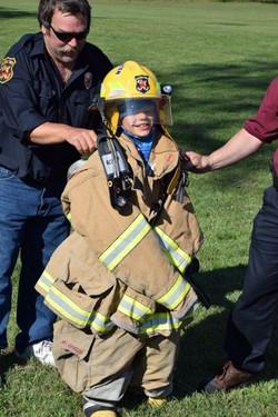 CR Trying on Fireman's Gear