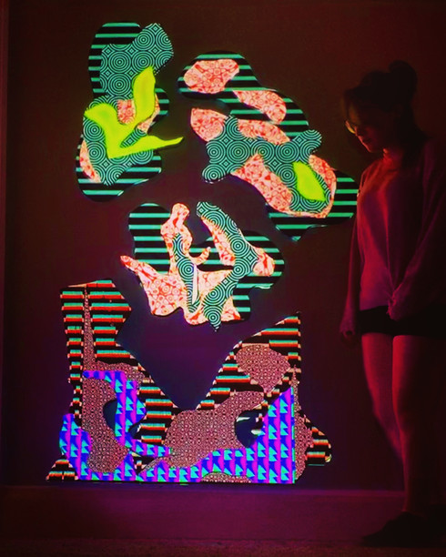 Standing Next To Sculpture, Neon Nights Collab