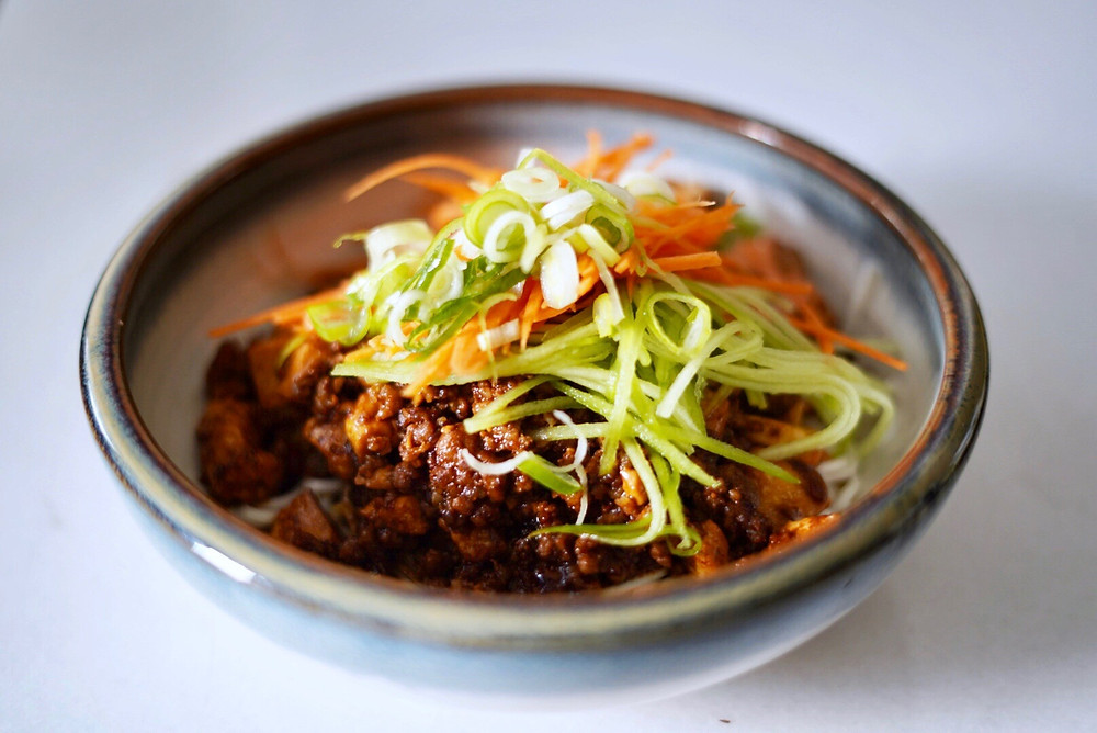 A savoury mince on shanghai noodles with carrots and cucumber