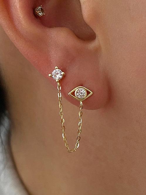 two earrings in one ear
