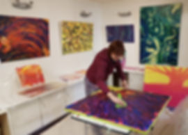 Charlotte Giblin painting in her studio