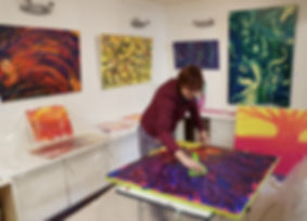 Charlotte Giblin painting in her studio