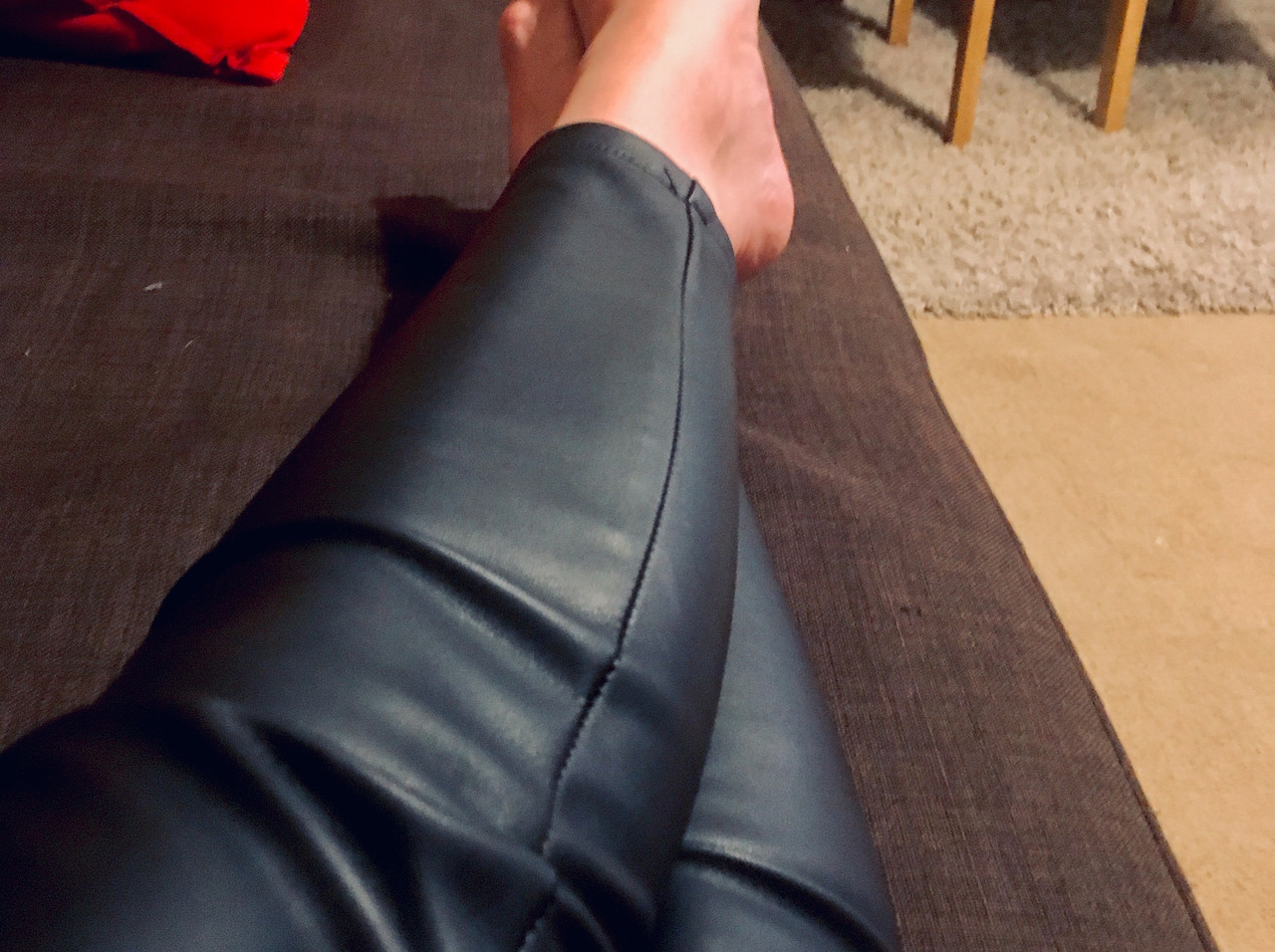 Mistress resting her feet but still in her leather trousers
