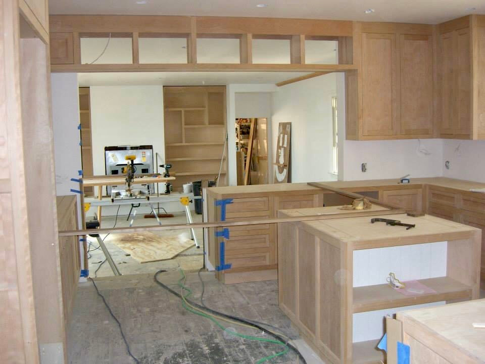 Custom built in cabinets, fireplace and kitchen