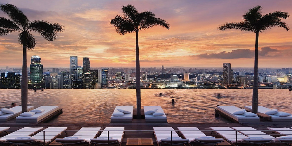 Above: At the Marina Bay Sands in Singapore, a rooftop swimming pool is 57 floors above street level and has a panoramic city view.