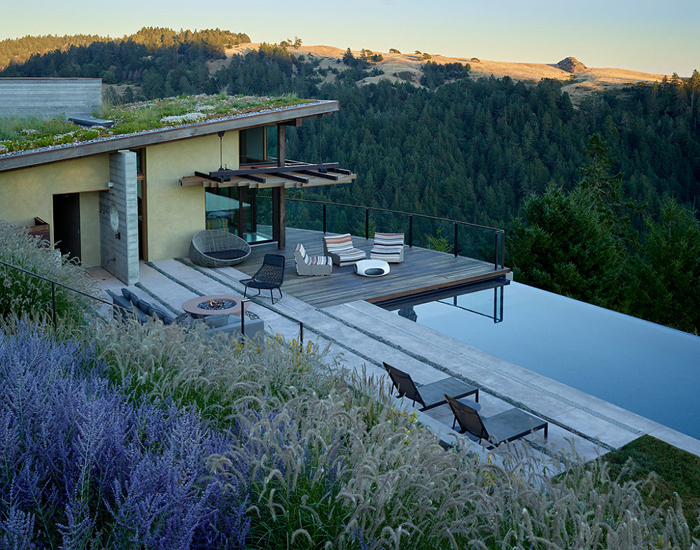 """Above: A landscape by designer Ive Haugeland with """"awe-inspiring views of the Pacific Ocean"""" in Sausalito, California has an infinity pool sited on a steep hillside."""