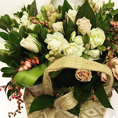 Natural coloured flax basket with Grandiflora flowers