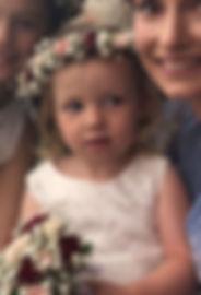Flower girl holding posy